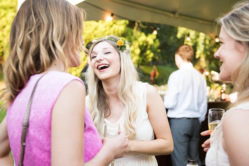 Wedding guests laugh at Busbridge Lake wedding Surrey