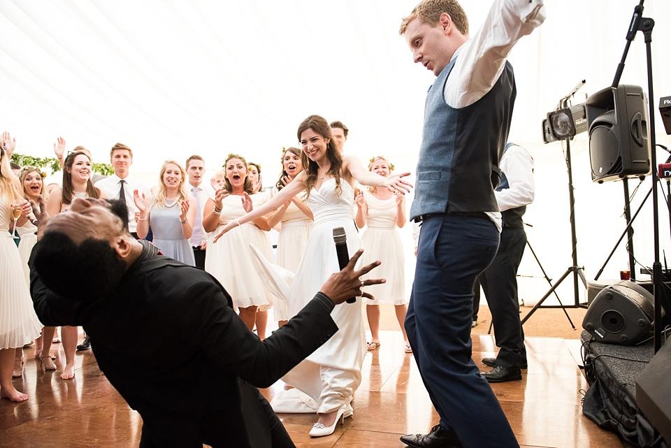 Fun bride and groom dancing Surrey wedding