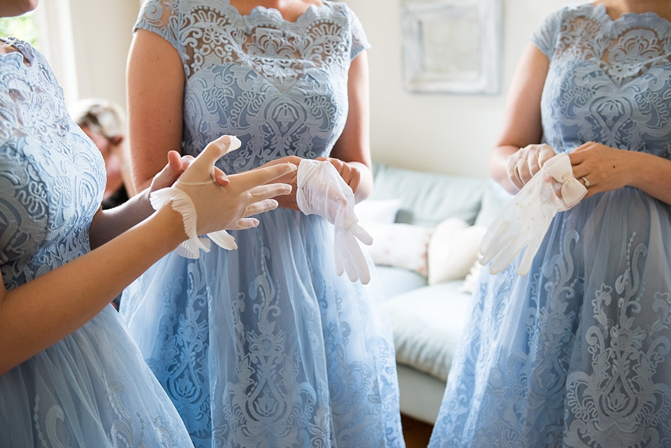 Bridesmaids in navy blue with white gloves Fetcham Park wedding