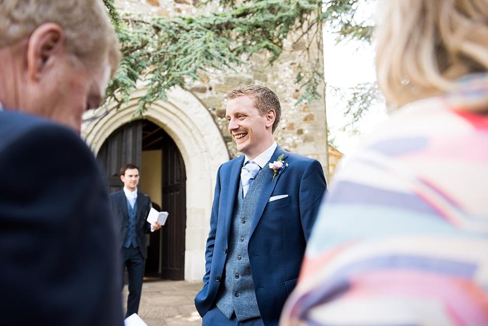Smiling groom pre-wedding morning Surrey