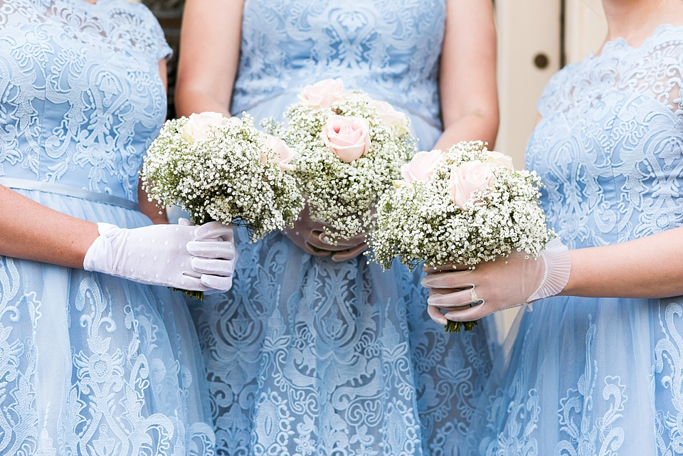 Trio of navy blue bridesmaids with gysophilia bouquet Fetcham Park wedding