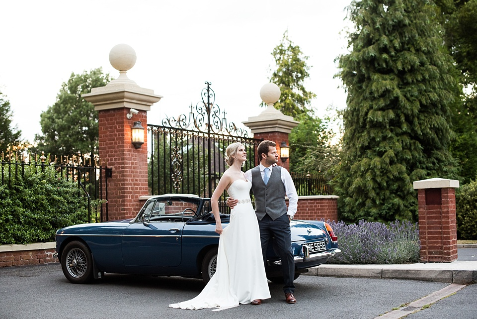 Bride with groom and vintage car Fetcham Park wedding