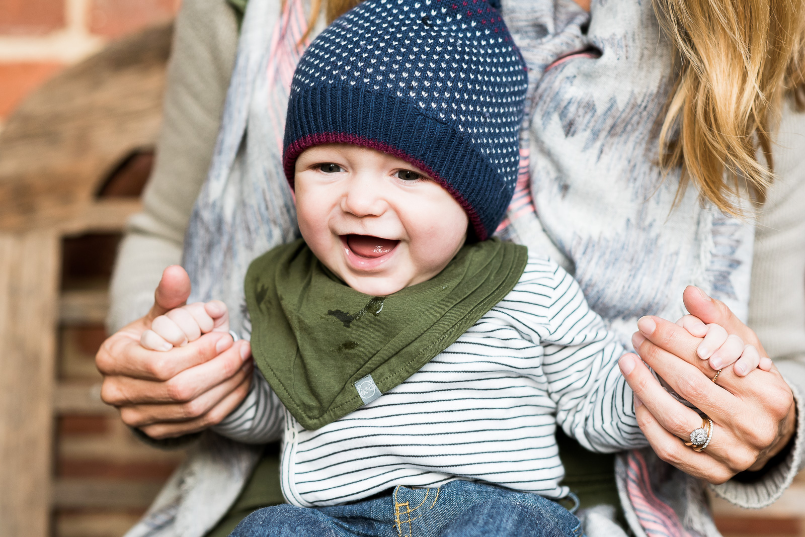 Cute toddler with blue hat family photography London