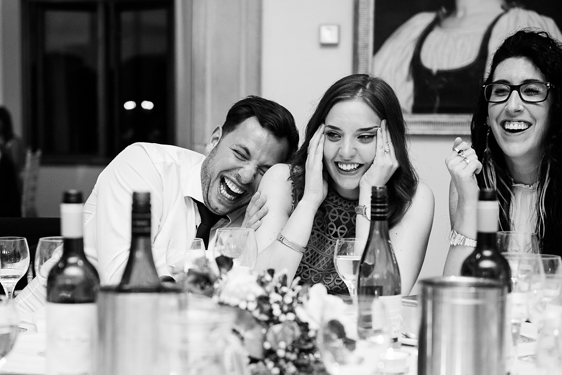 Laughing wedding guests Associate Wedding Photographer
