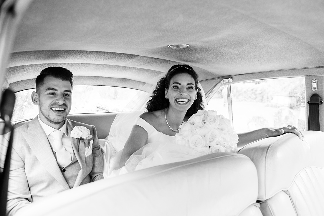 Laughing bride with groom Associate Wedding Photographer