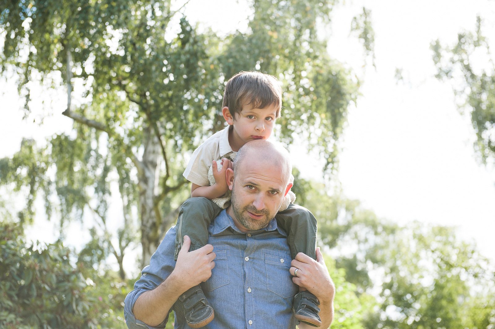 Father with son on shoulders natural family photography