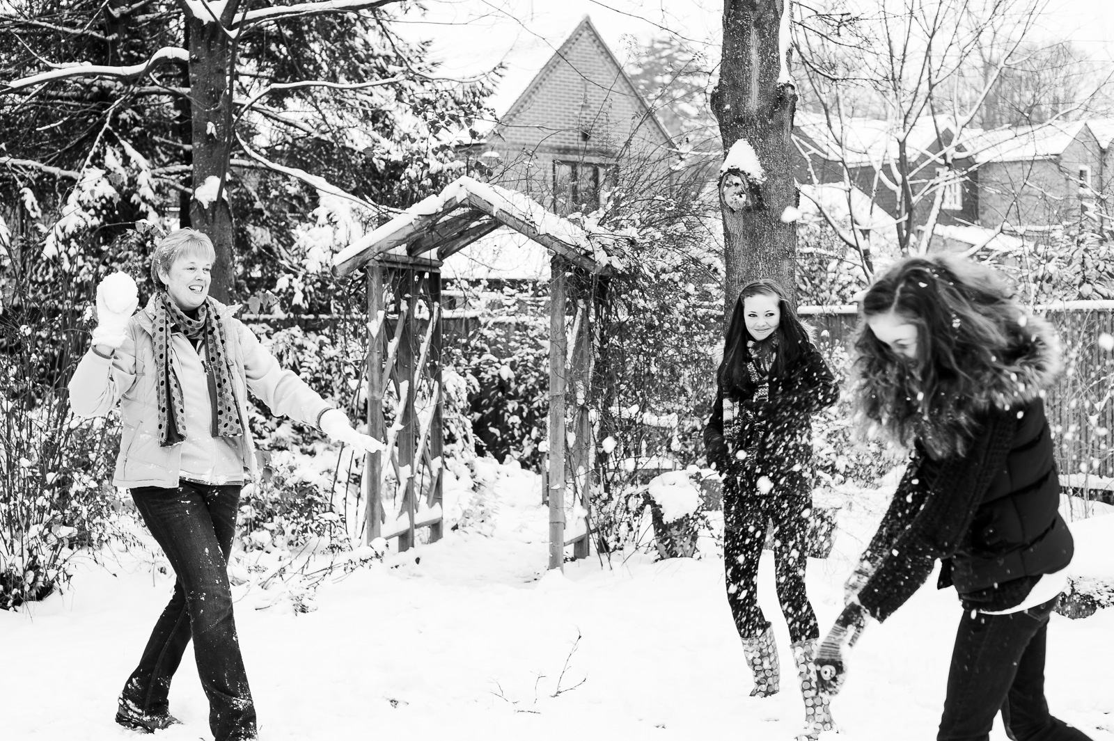 Snow fight creative family photography