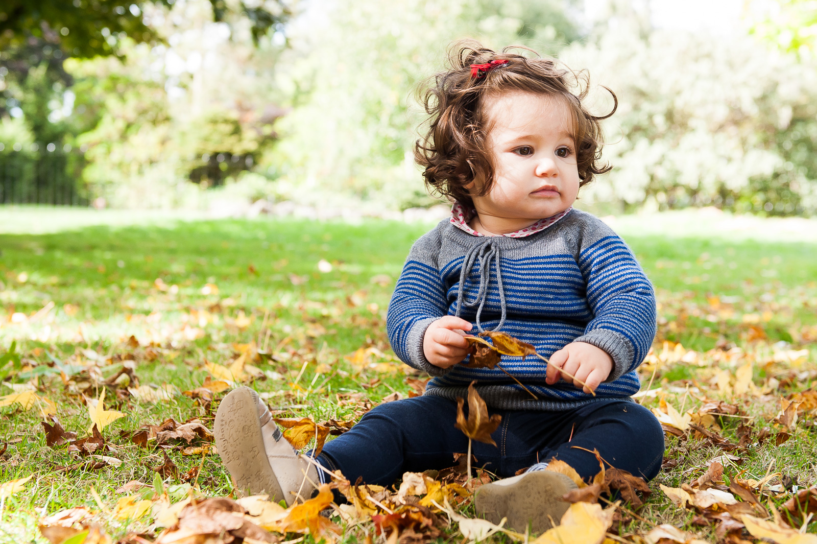 Cute girl playing with leaves relaxed photography style