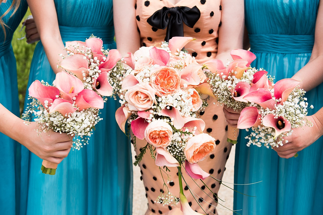Bride with bridesmaids floral bouquets Associate Wedding Photographer