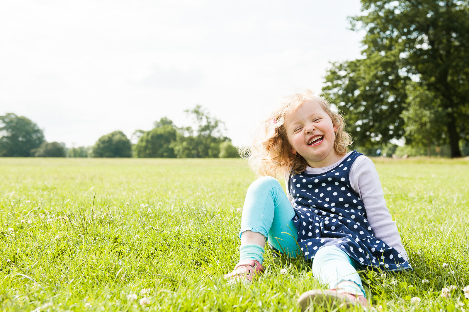 Relaxed photography style little girl with giggles
