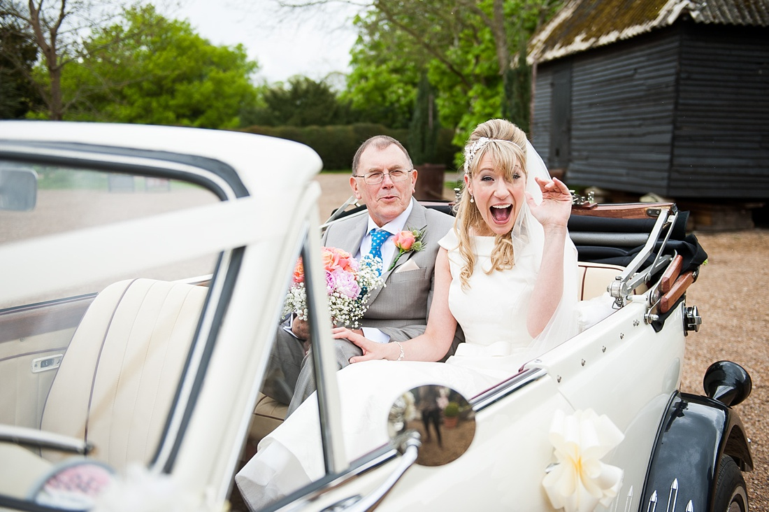Bride with Father arrives at Preston Court wedding in vintage car