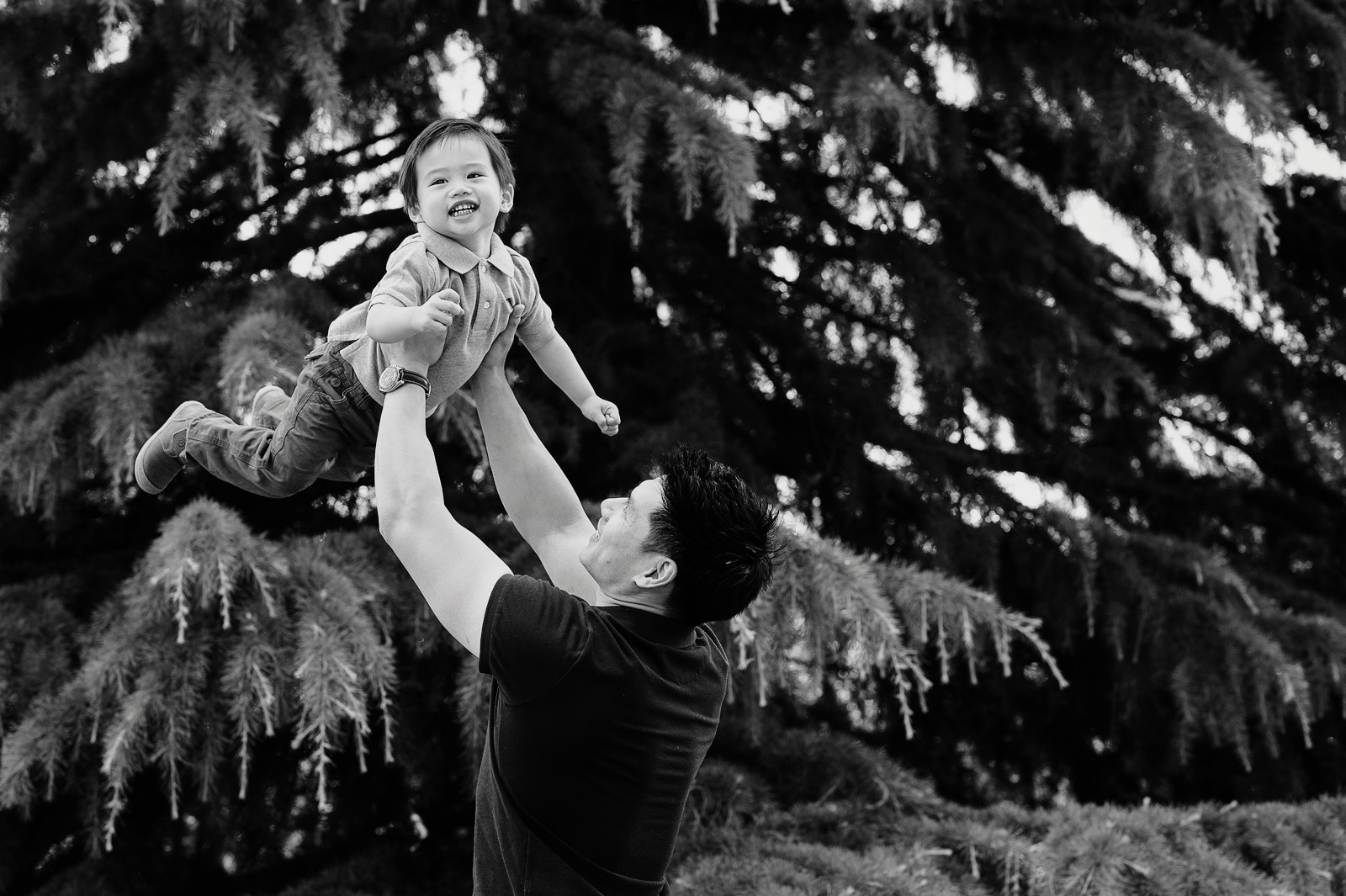Dad lifting son creative family photographer Greenwich Park London