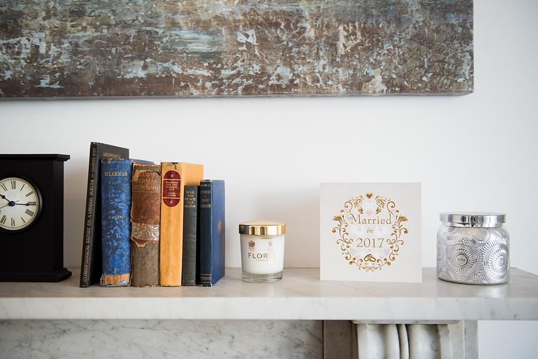 Shelf with gold wedding stationery elegant London wedding