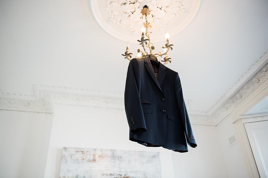 Ted Baker wedding suit hanging from golden light London