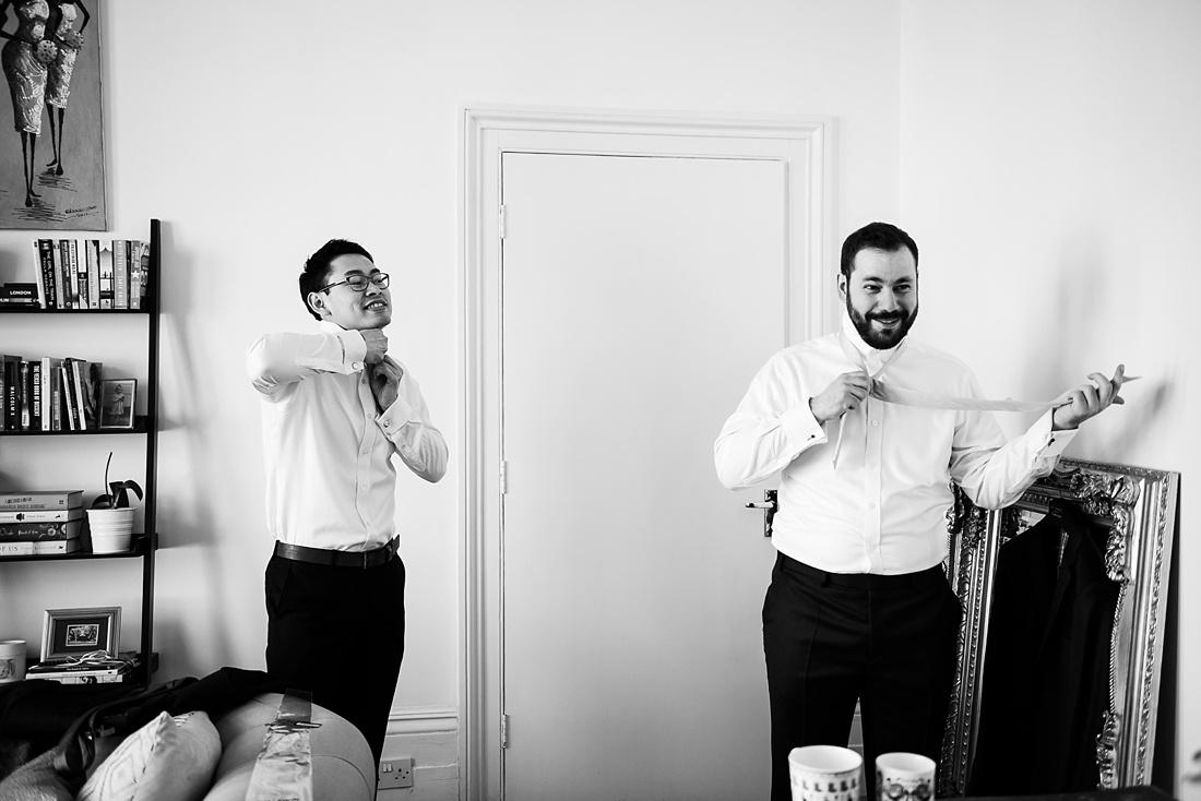 Fun pre wedding photography groom with best man London