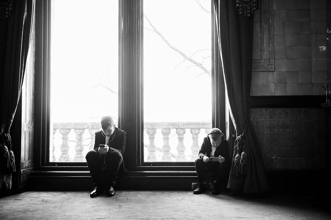 Wedding guests play on phone London wedding