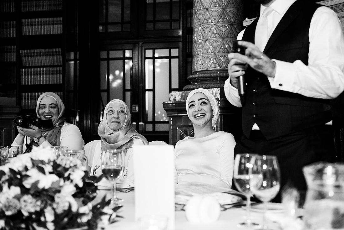 Bride giggles during groom wedding speech London