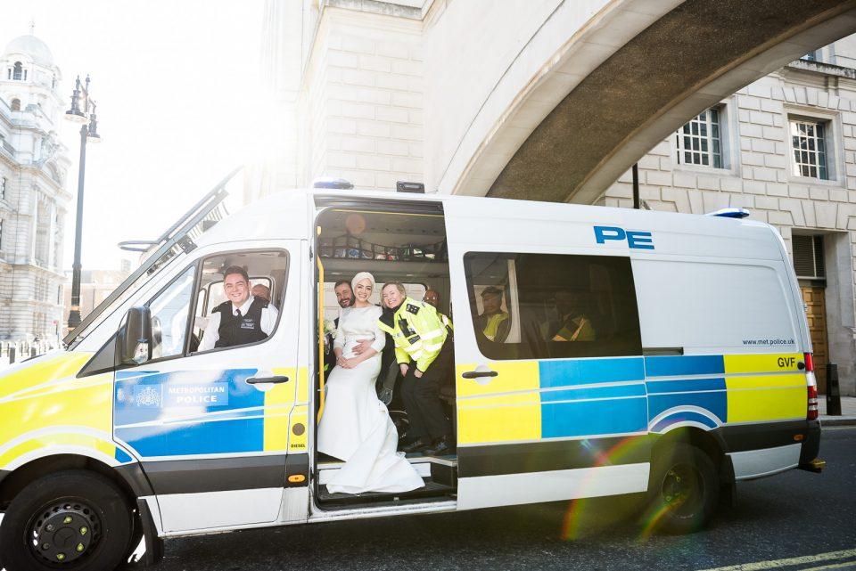 bride and groom sat in police van