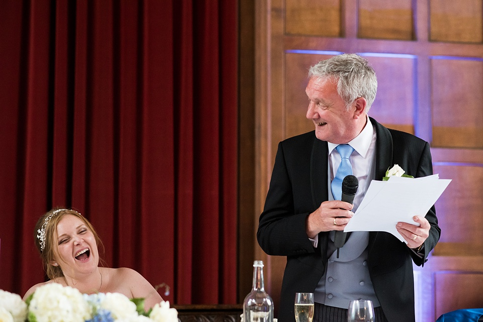 Laughing bride during wedding speech Eltham Palace Londo