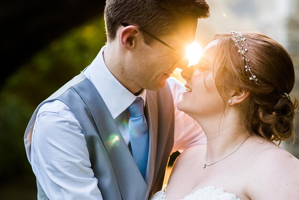 Magical sunlight wedding portrait Eltham Palace London