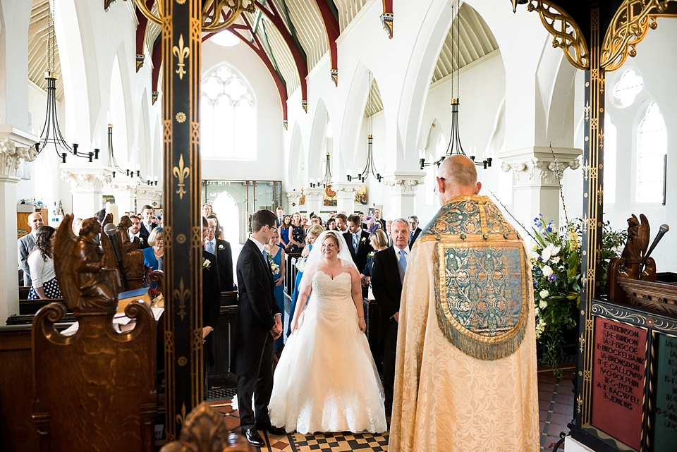 Bride wearing With Love Bridal dress with groom London church wedding ceremony