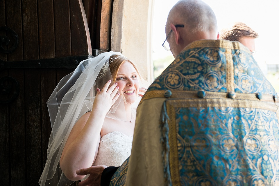 Smiling bride with Vicar London church wedding