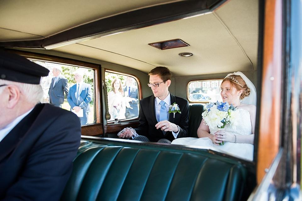 Bride with groom in vintage car London