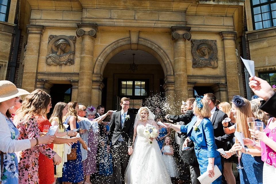 Fun confetti wedding portrait Eltham Palace London