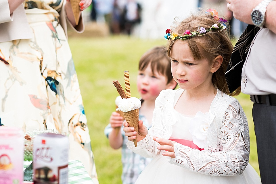 Children at weddings with large ice cream