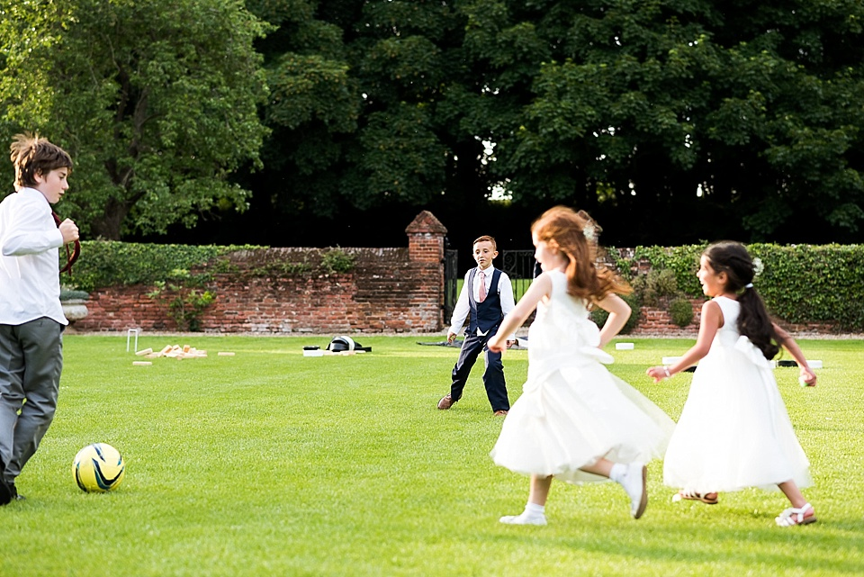 Children playing outside relaxed wedding photography style