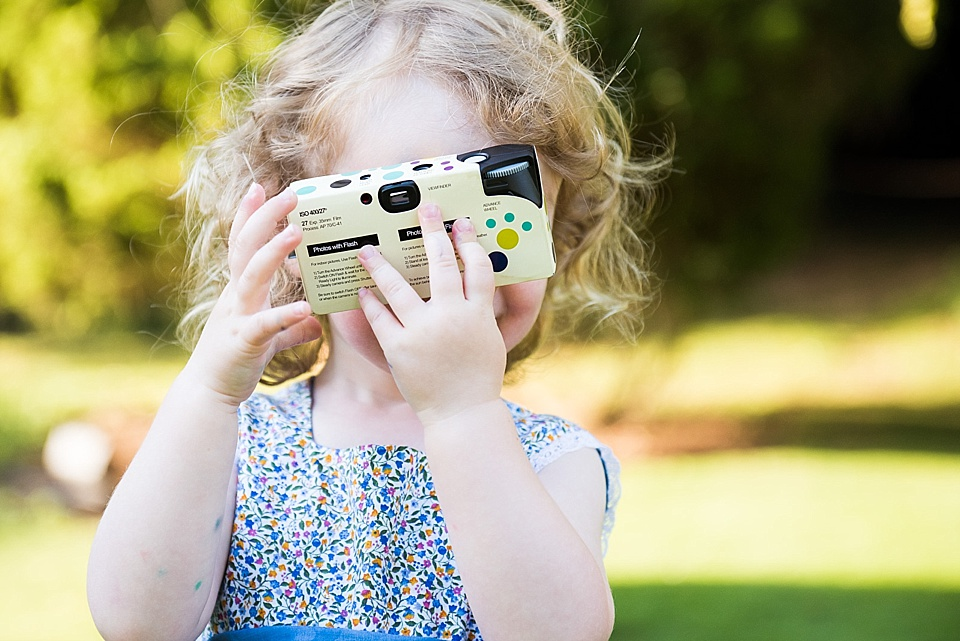 Child with portable camera natural wedding photography