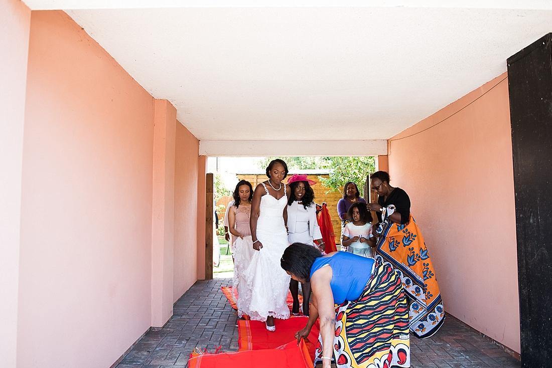 Burr Bridal with family walking red carpet Kenyan wedding