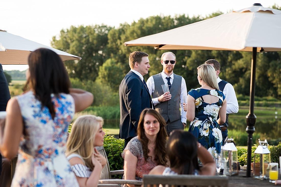 Wedding guests enjoy summer outside drinks