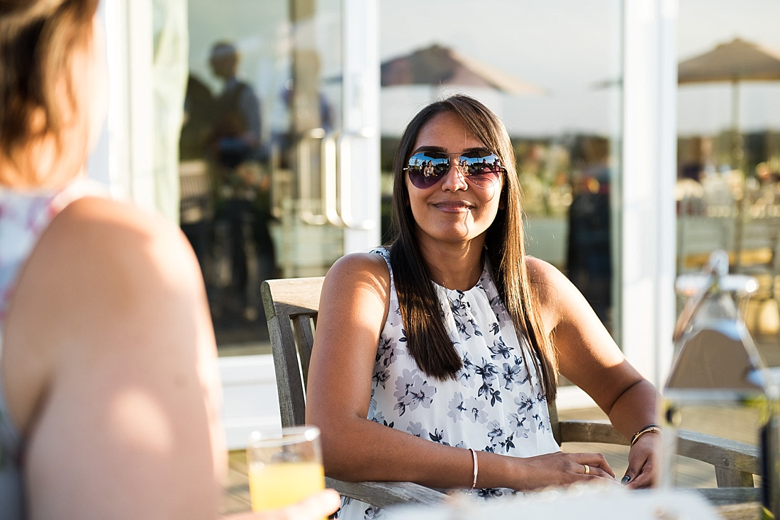 Smiling wedding guest wearing sunglasses