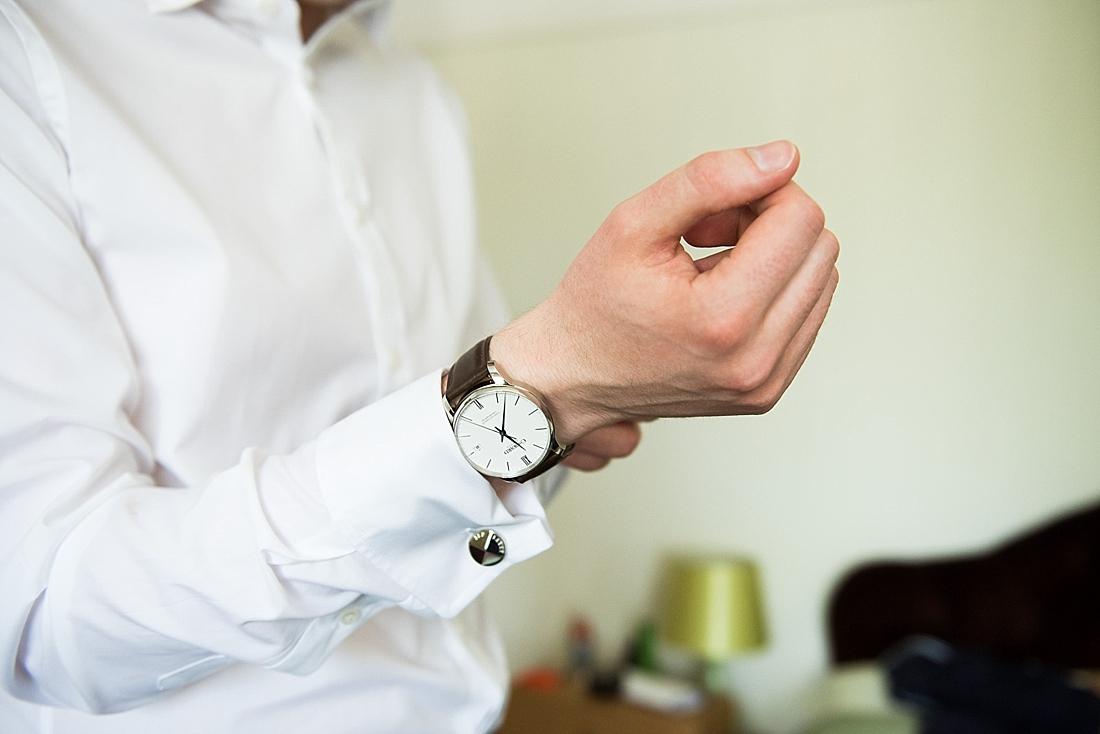 Groom wearing watch pre wedding photography