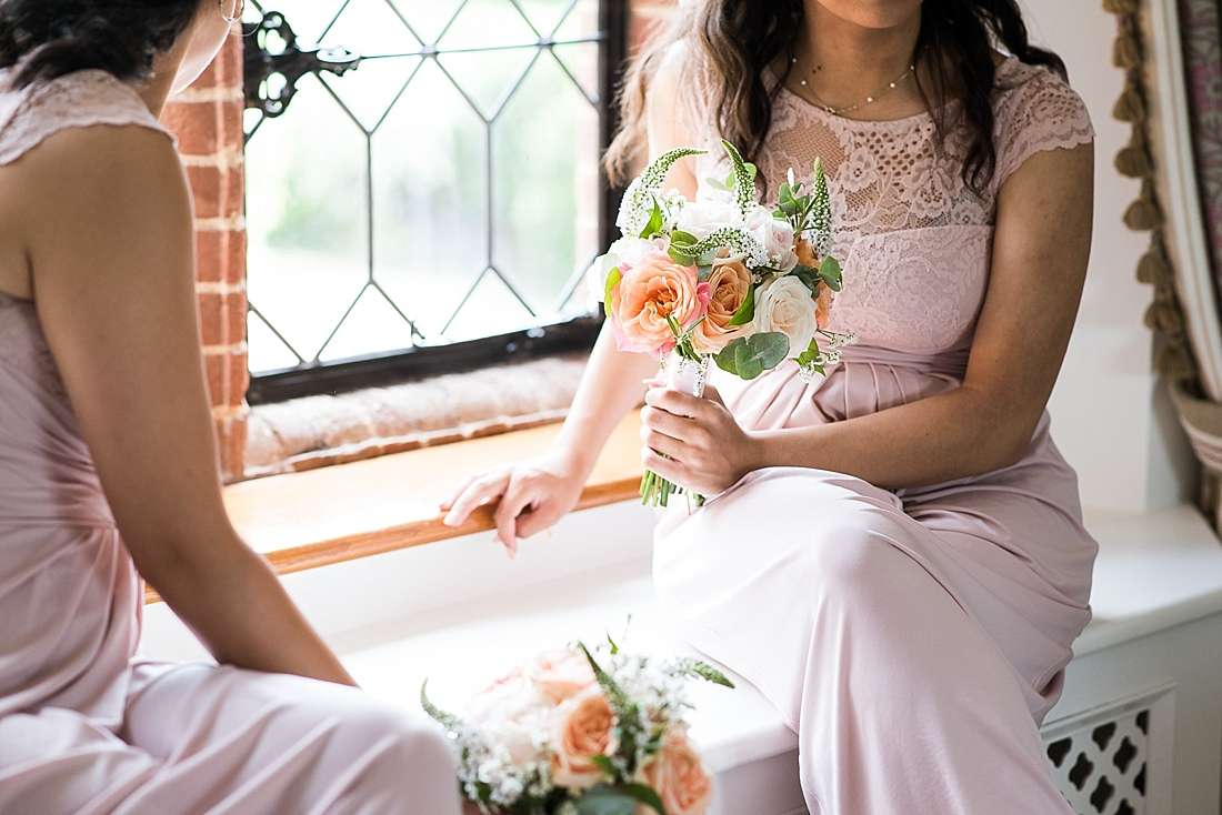 Pastel pink Asos bridesmaids holding bouquet by Larkspur Floral Design