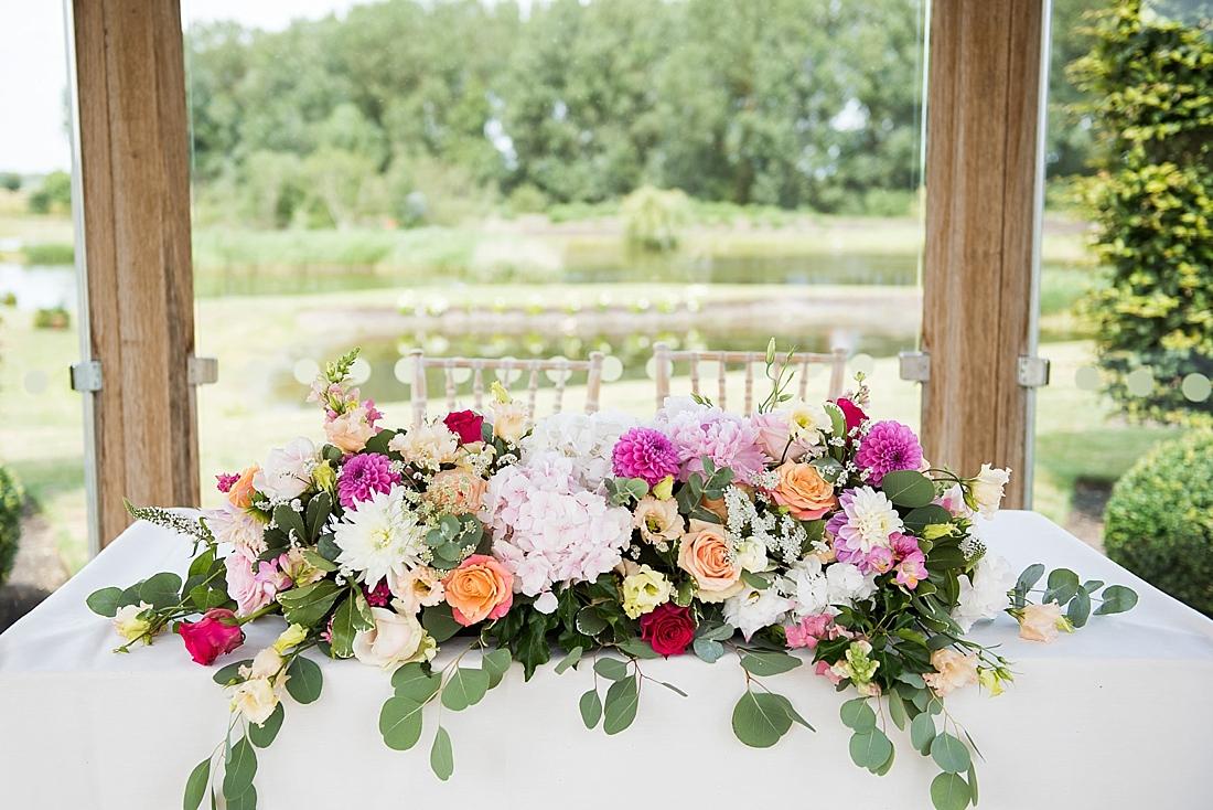 Beautiful summer floral decor by Larkspur Floral Design