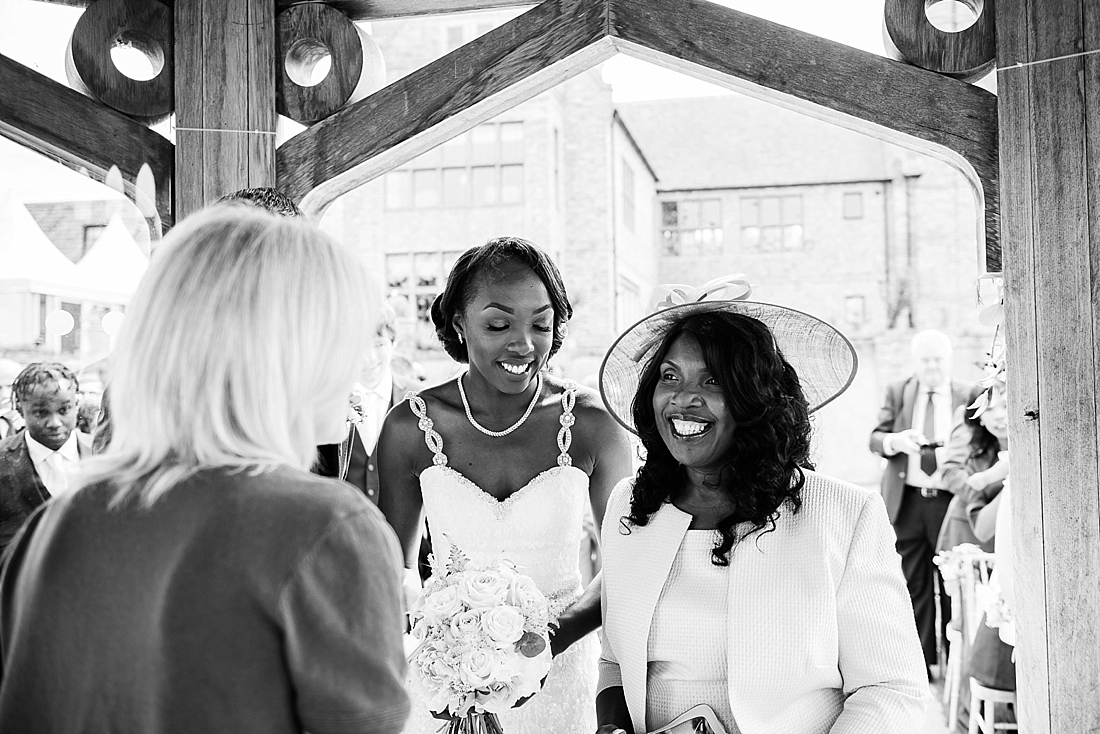 Smiling mother with beautiful bride wearing Burr Bridal