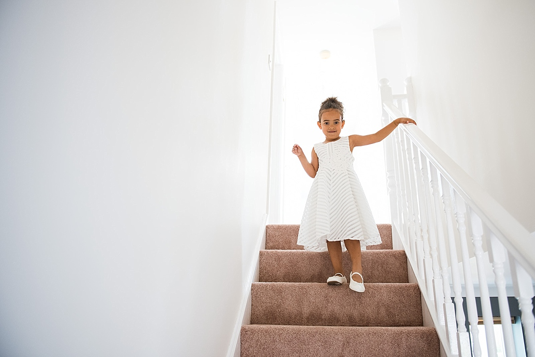 Adorable flower girl walking stairs pre wedding photography