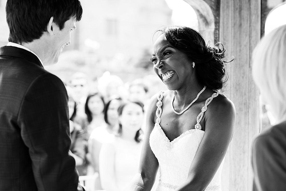 Smiling Burr Bridal looking at Ted Baker groom