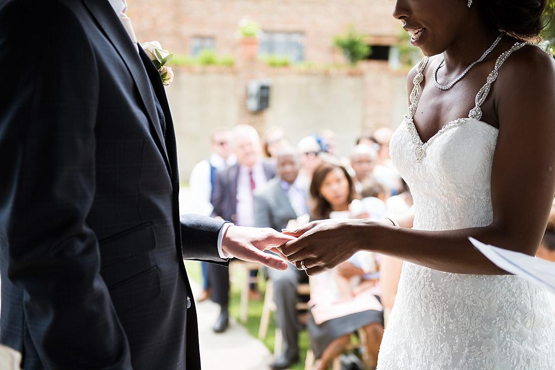 Stylish Burr Bridal exchanging wedding ring Ted Baker groom