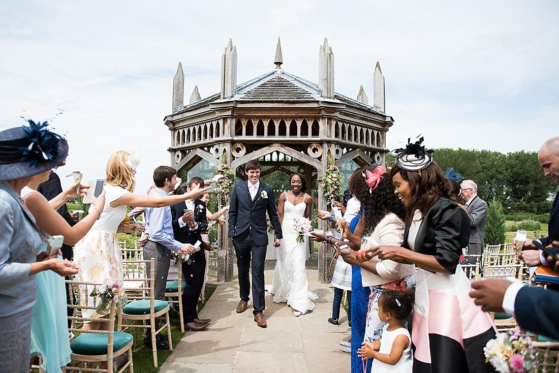 Beautiful outdoor wedding ceremony confetti fun