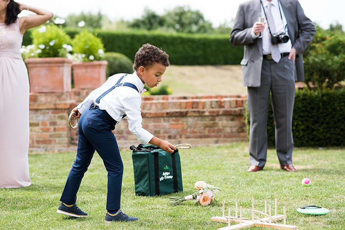 Child plays outdoor wedding game