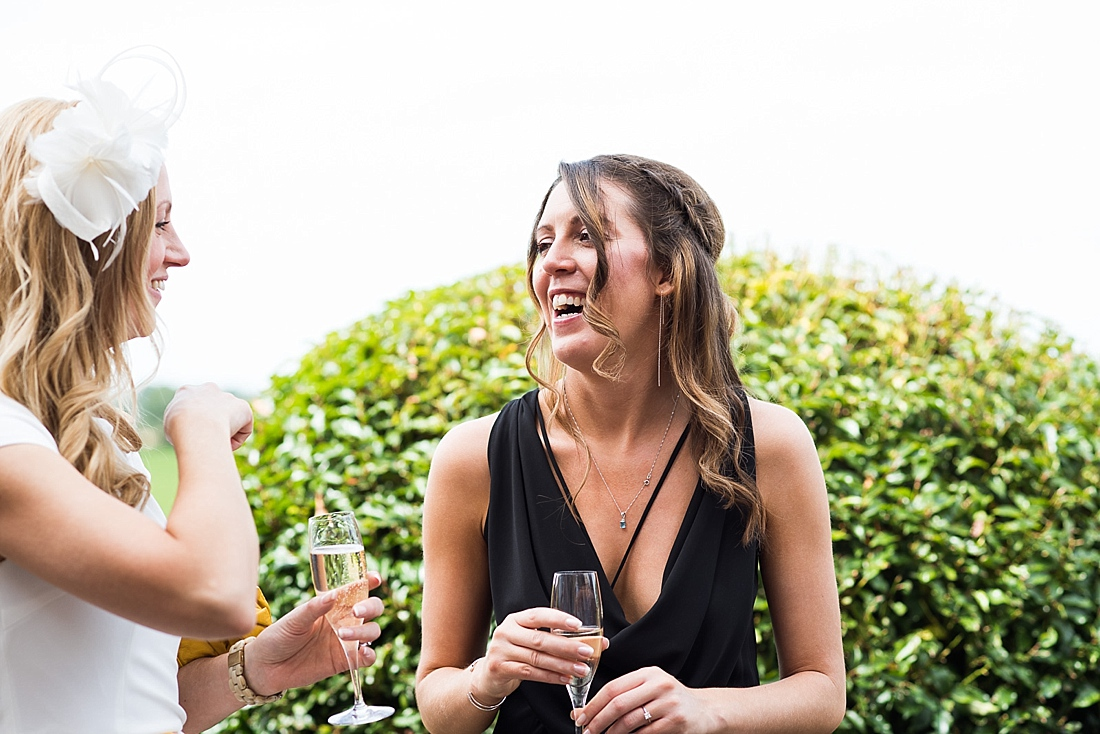 Laughing boho dressed wedding guest