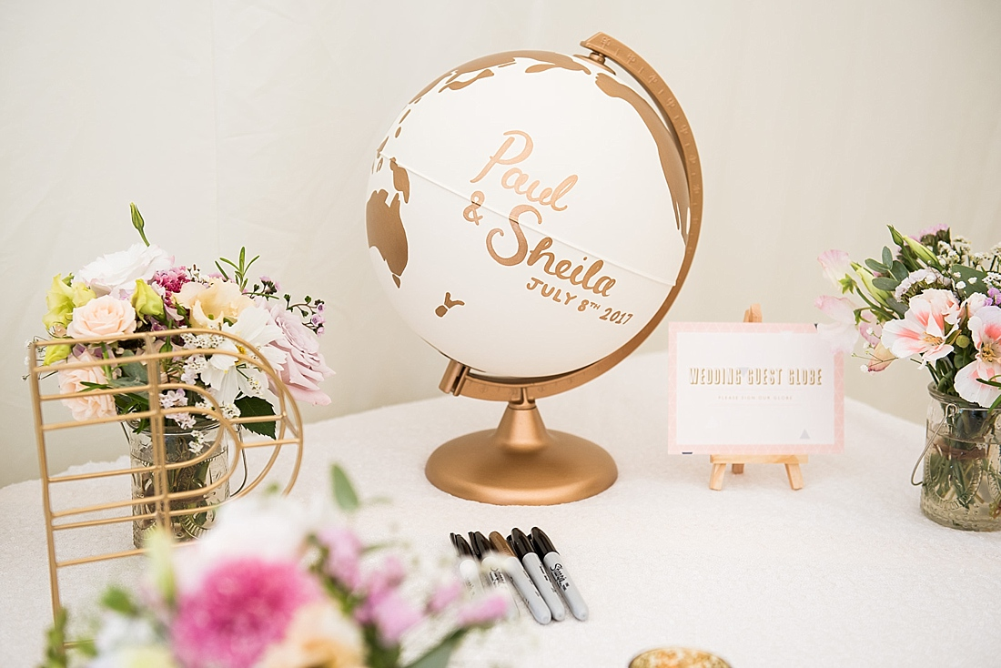 White & gold globe wedding guests leave wedding day message