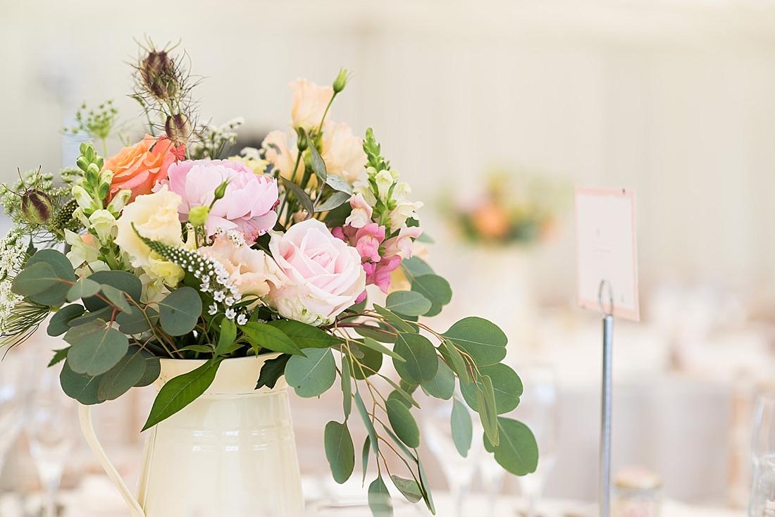 Summer pastel wedding table flower decor Larkspur Floral Design
