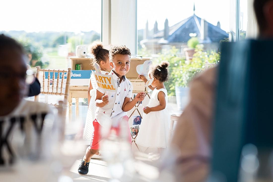 Children play lively summer wedding
