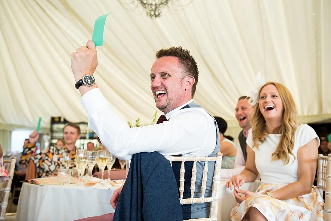 Fun laughing wedding guests