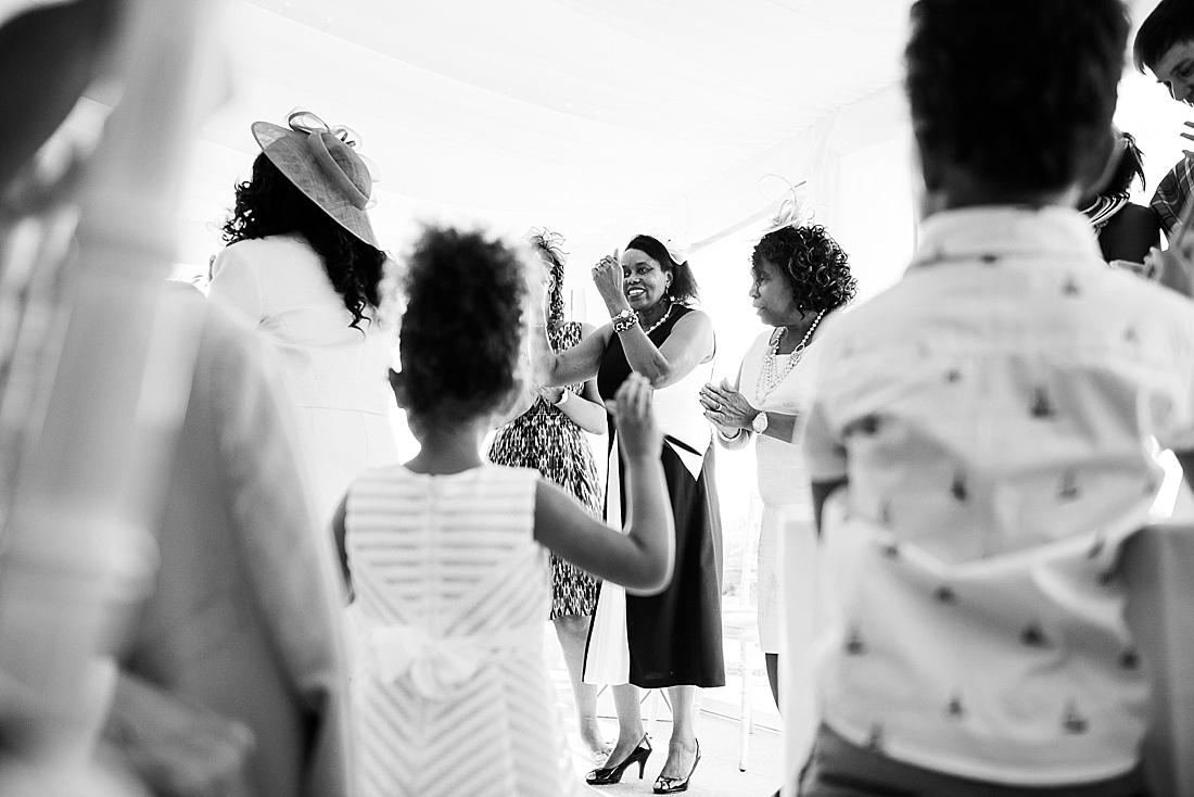 Wedding guests cheer bride and groom