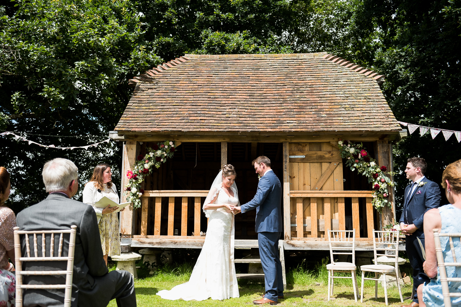 Outdoor rustic wedding ceremony hosted by wedding celebrant